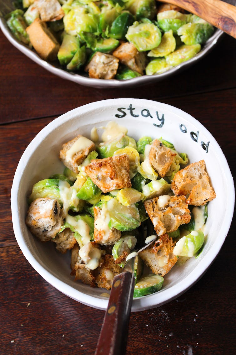 served up Brussels sprouts and caesar salad on a bowl