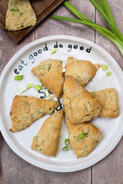 plate of 7 spring onion scones garnished with spring onion