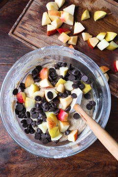 Muffin batter with apple and chocolate in bowl