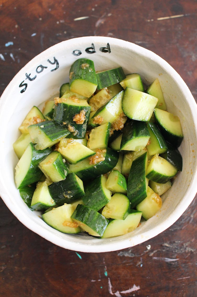 smacked cucumber salad served on a bowl