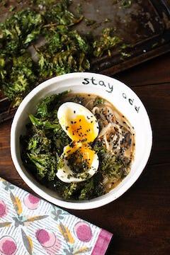 served kale broth noodles on a bowl