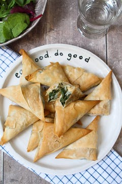A plate with a pile of Spinach Filo Parcels.