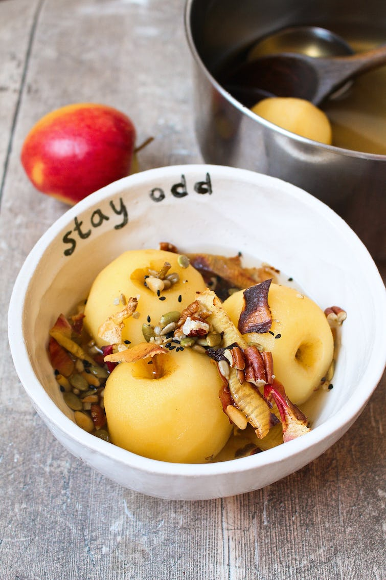 poached apple served with nuts and seed in a bowl