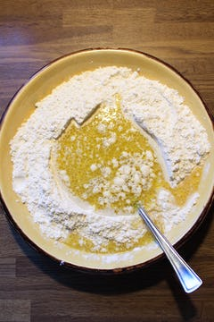 oil and other ingredients added to the flour bowl