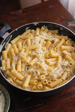 dried pasta added to the pan