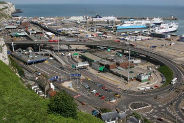 overview image of city road containing vehicles and bridge