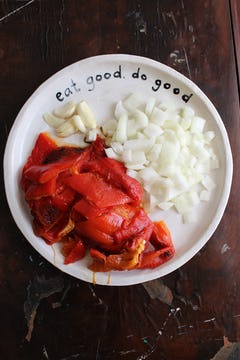 chopped bell peppers, onion and garlic on a plate