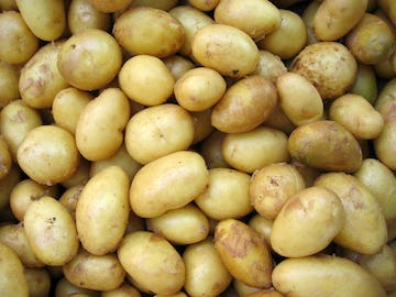 A large pile of potatoes.