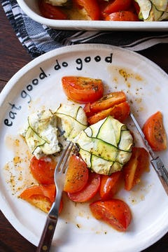 plated courgette and broccoli parcels with roasted tomatoes