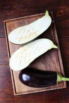 cut aubergine with score on the flesh