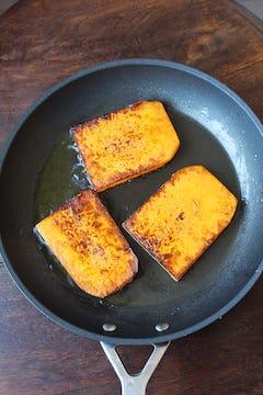 Butternut squash cooking in frying pan