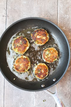 5 potato cake being cooked in a frying pan