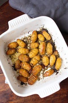 Cooked potatoes in roasting pan