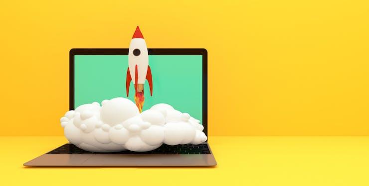Notebook com ilustração de um foguete decolando da tela