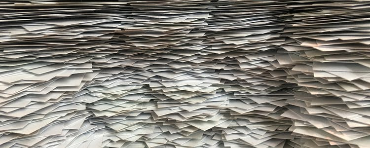 Overwhelming pile of paper
