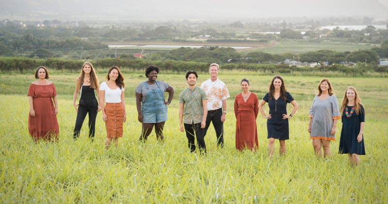 Photo of the Elemental Excelerator team of people standing outside in an open field