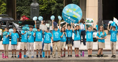 Photo of a group of children at a Blue Planet Foundation rally at the Hawai'i State Capitol
