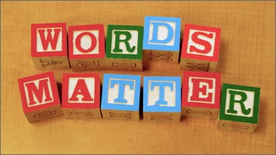 """Photo of toy blocks spelling out """"Words Matter"""""""