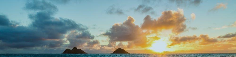 Photo of sunrise over ocean horizon