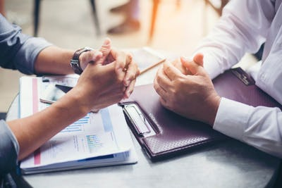 Photo of hands during a business meeting.