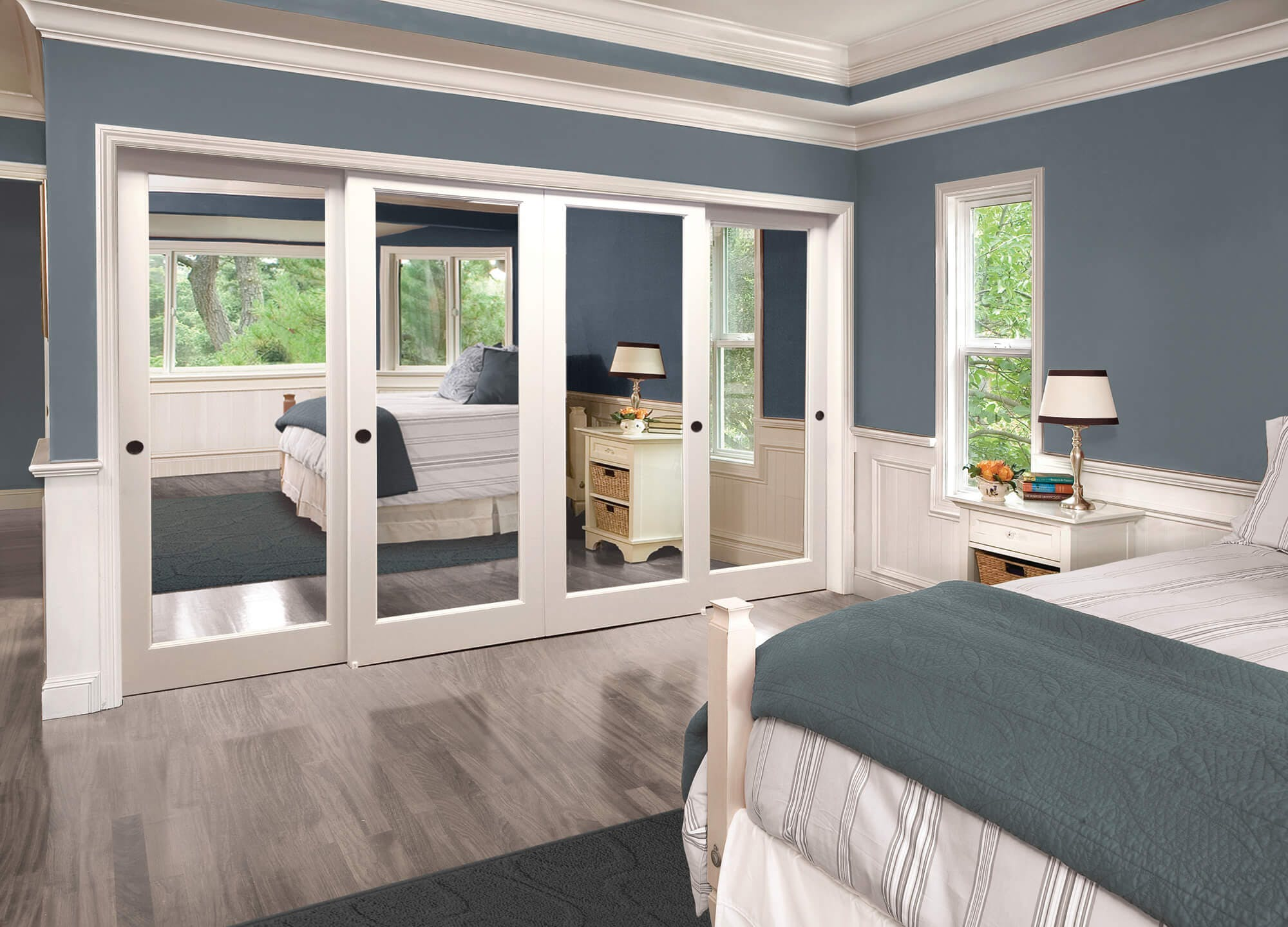 A four-panel closet in a blue bedroom.