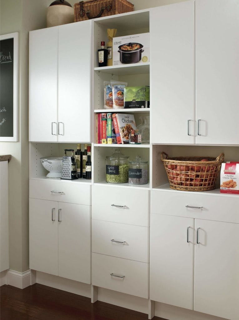 A white storage pantry in a new kitchen.