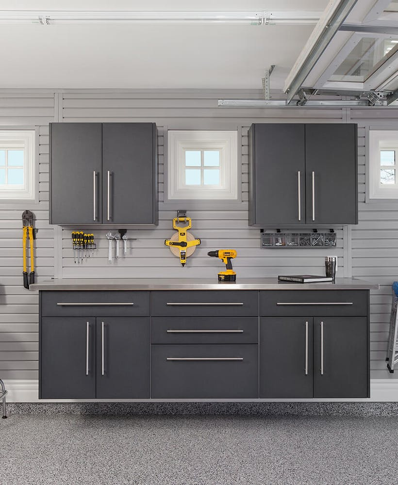 Garage storage, with a workbench and cabinets.
