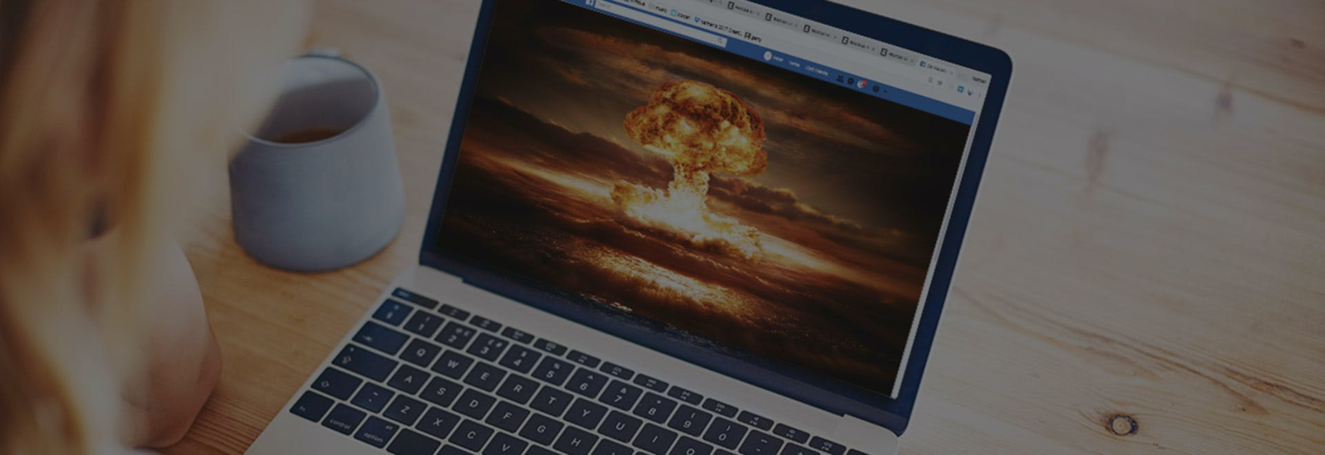 laptop with bomb explosion image on screen