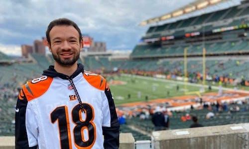 Young man at NFL football game