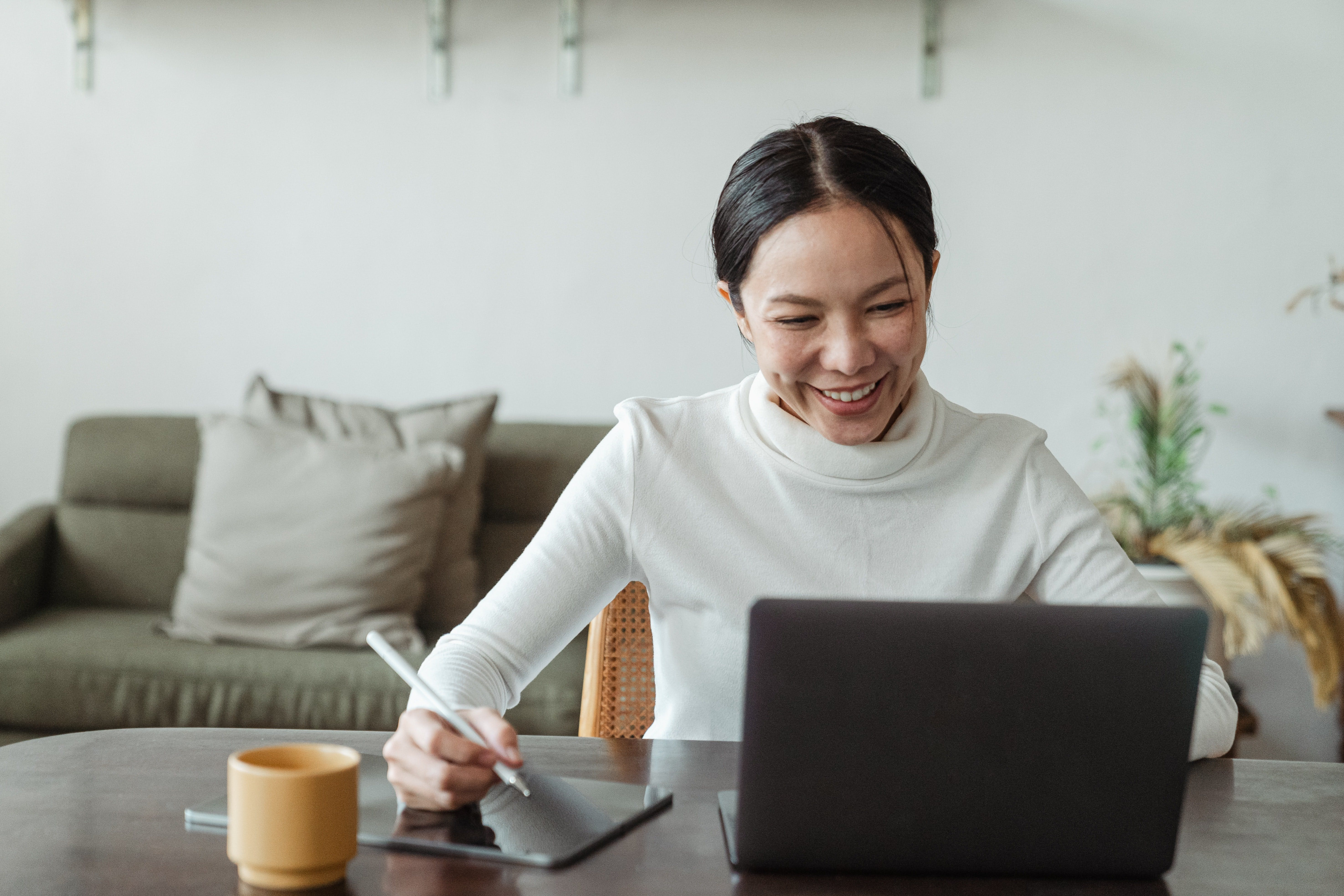 Woman working from home and laughing