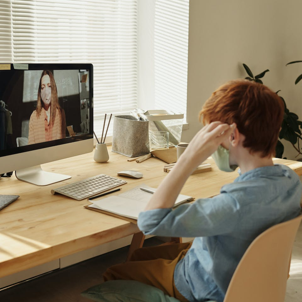 Student studying from home on an online class.