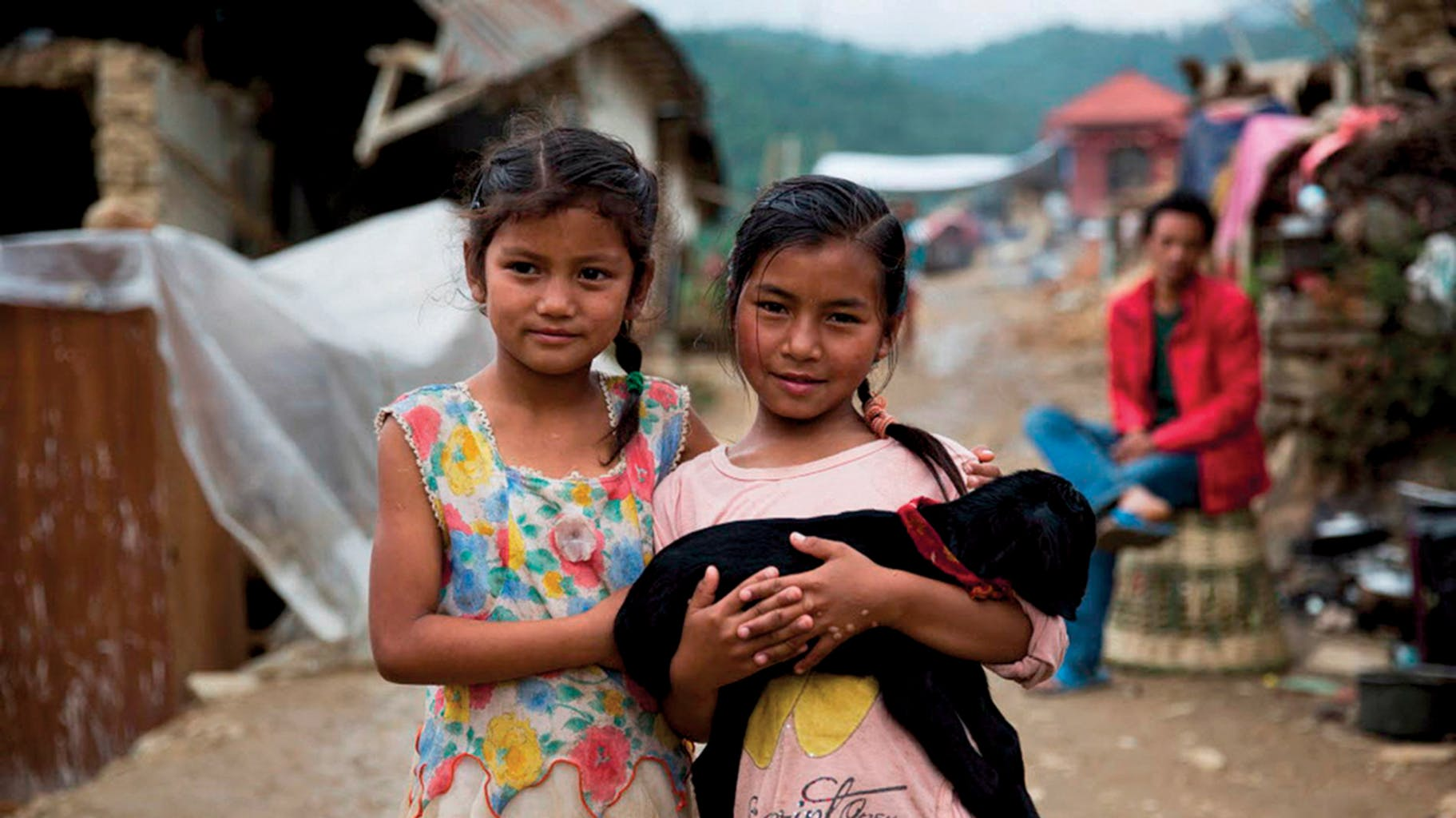 Girls with one of their surviving goats in Nepal's Lalitpur District, after the 2015 earthquake, which killed 9,000 people and countless animals, including  livestock; this created hardships for farmers and rural communities here, which depend on animals for food.