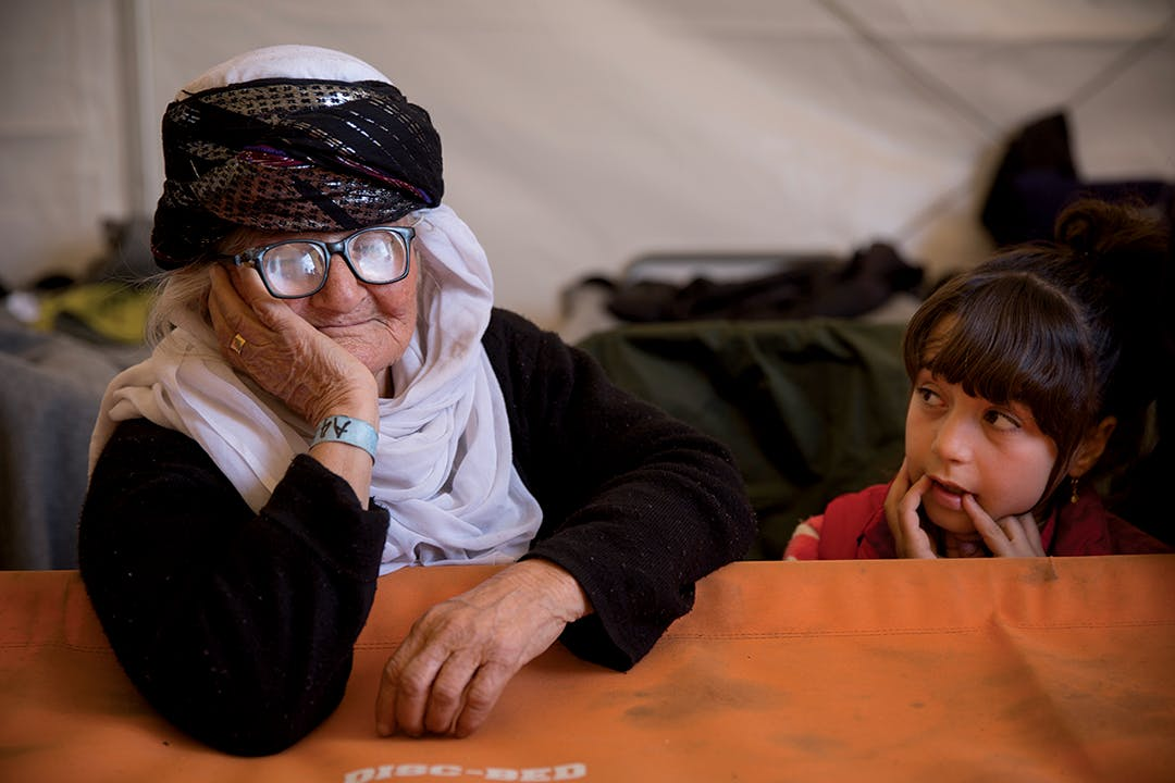 Shereen, an 85 year-old Yazidi grandmother who escaped the ISIS onslaught in Sinjar (aka Shengal), Iraq, in a tent at Idomeni Camp in Greece. One of her two grown sons is in Germany, the other in Sweden. Akram Hamo, her nephew, said he and his family helped bring her to Europe.