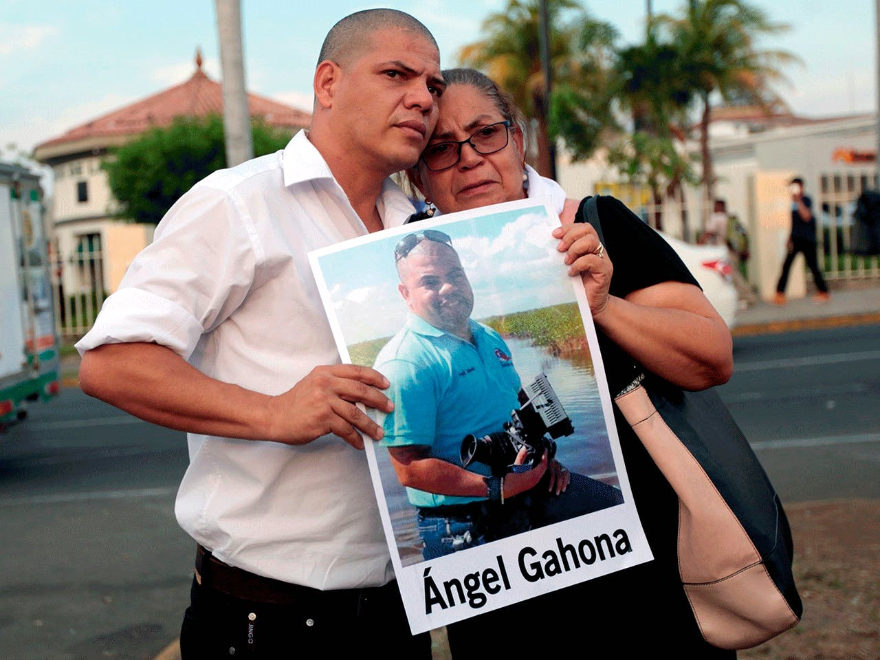 THE MOTHER AND BROTHER OF JOURNALIST ÁNGEL GAHONA—WHO DIED DURING THE PROTESTS FOLLOWING AN ATTEMPT BY PRESIDENT DANIEL ORTEGA TO REFORM THE NEAR-BANKRUPT SOCIAL SECURITY SYSTEM — TAKE PART IN A PROTEST AT THE RUBEN DARIO ROUNDABOUT IN MANAGUA, MAY 10, 2018