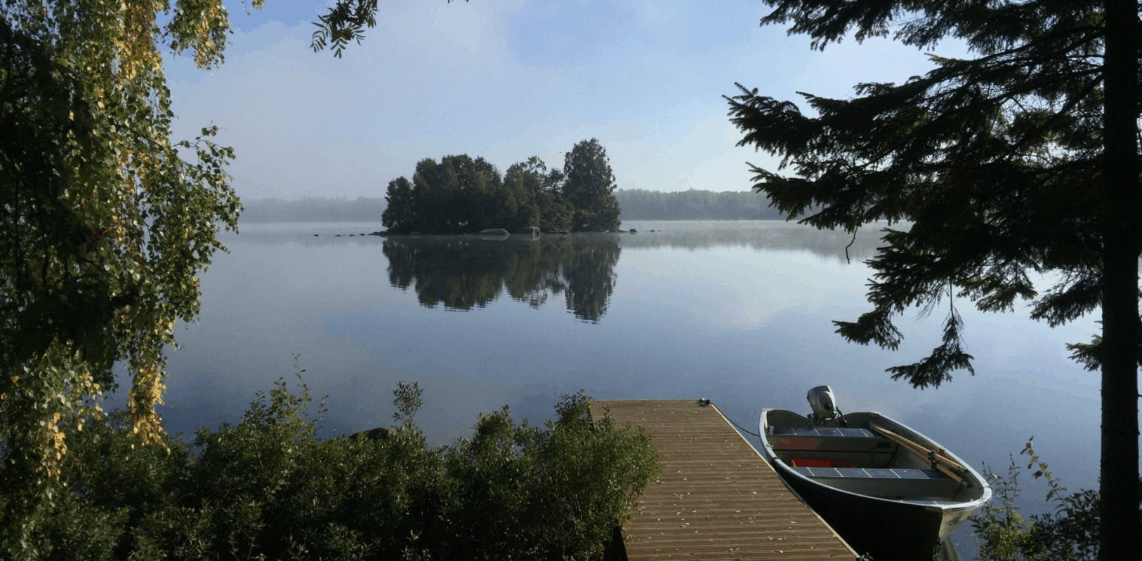 view over a lake with a boat