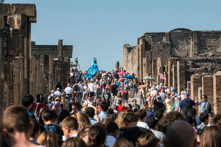 Visitors on Via dell' Abbondanza in Pompeii. The site is set to receive a record-breaking number of visitors this year.