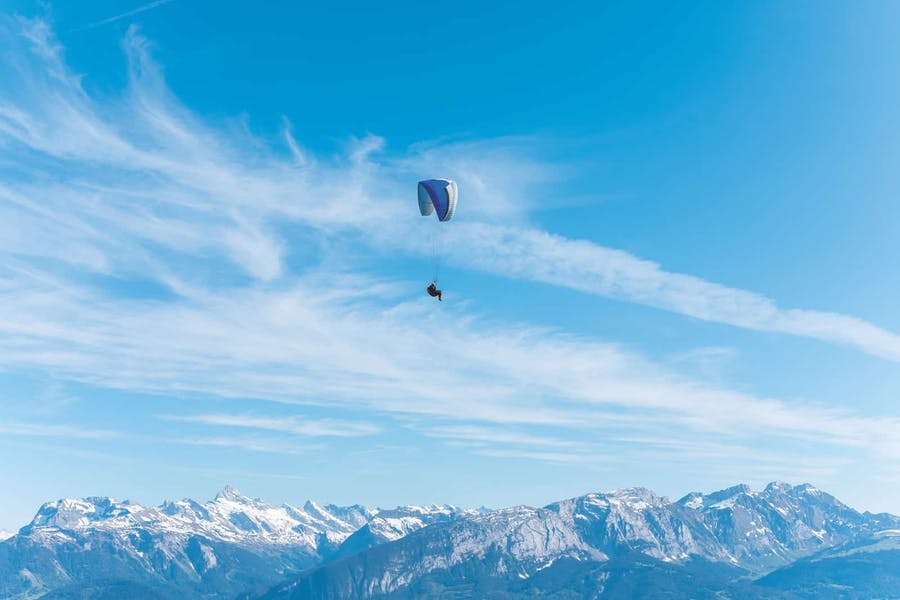 A paraglider above the Alps