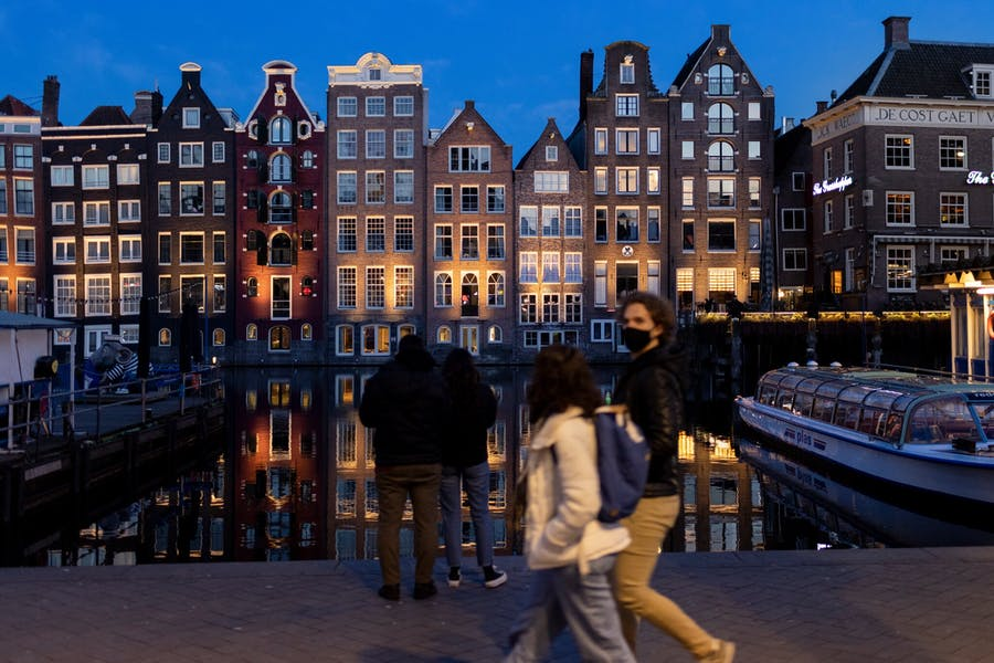 Empty canal boats in the center of Amsterdam. Ilvy Njiokiktjien for The New York Times