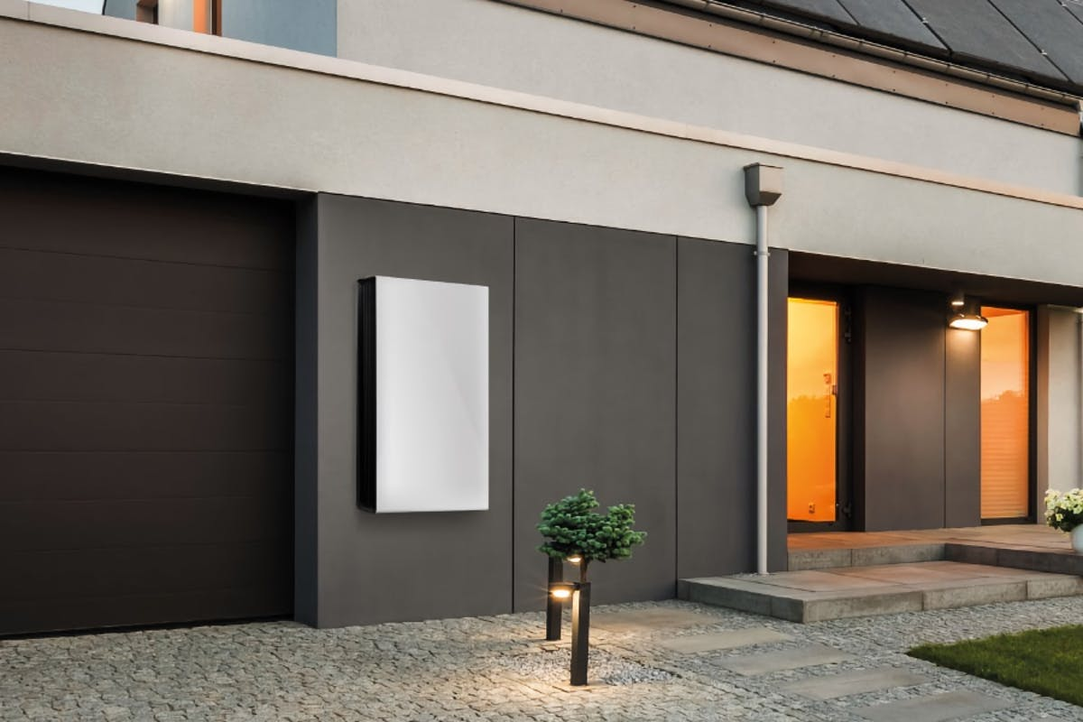 A solar battery mounted to the wall of a solar powered home to provide energy storage.