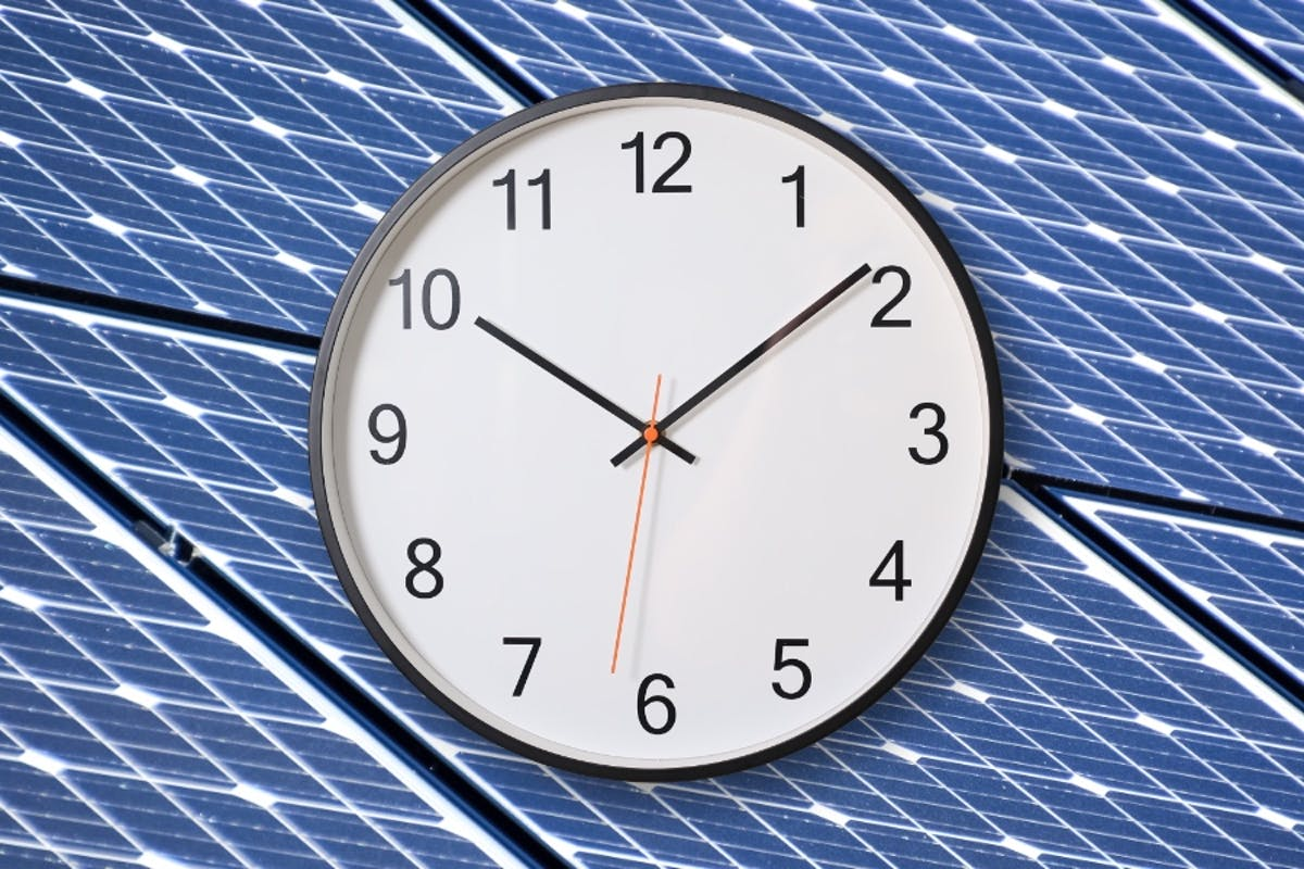 A clock over solar panels, highlighting a shift to Time-of-Use Rates, and potential TOU savings with home solar.
