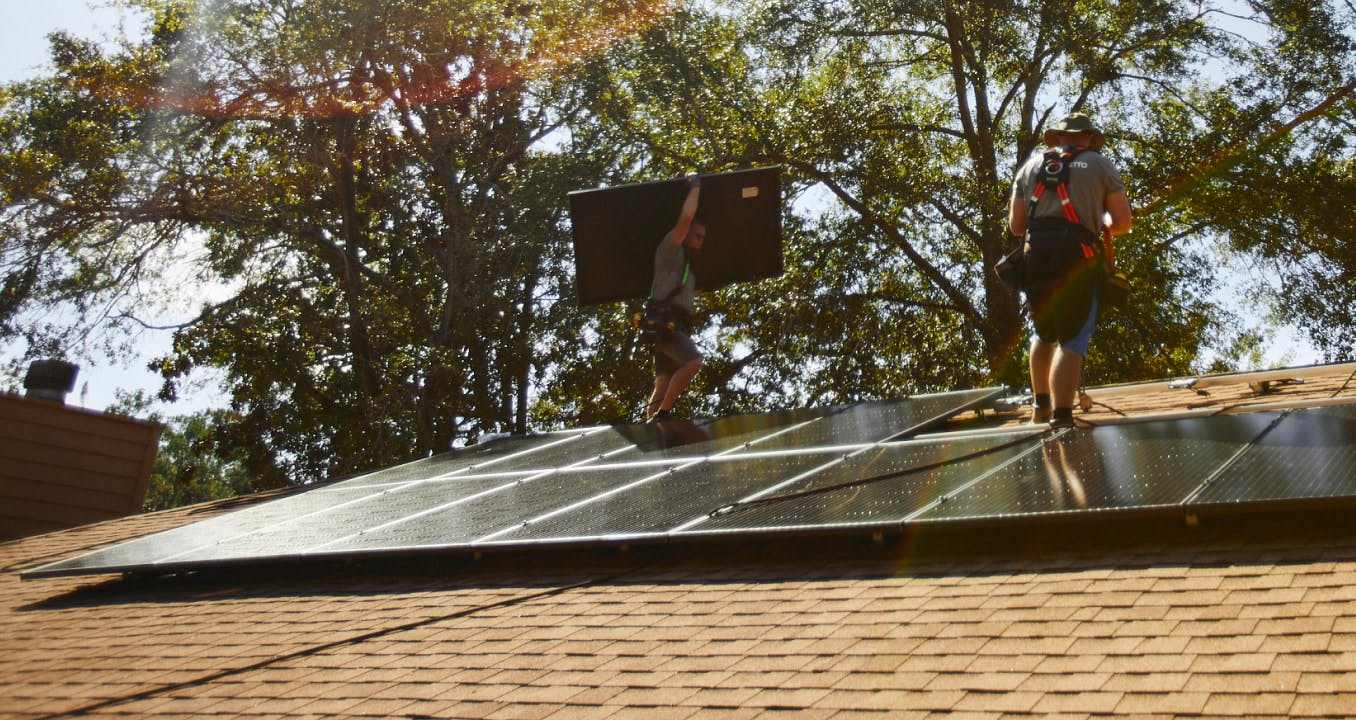 Palmetto solar panels being installed on a home's roof.