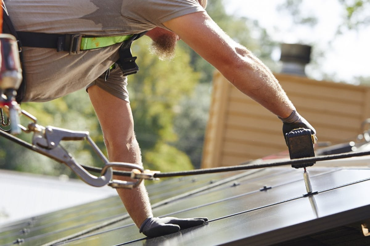 Palmetto Solar Installers Adding Panels To The Roof Of A Home