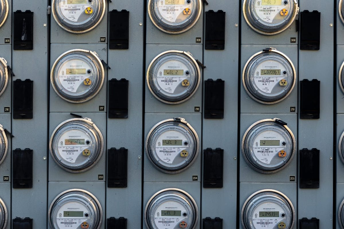 A wall of electric meters measuring electricity from the utility.