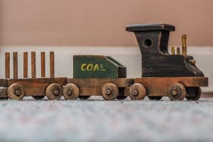A Toy Train With A Coal Car