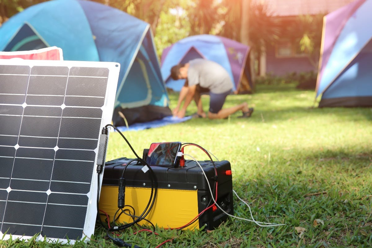 A solar generator being used to provide portable solar power and clean energy while camping.