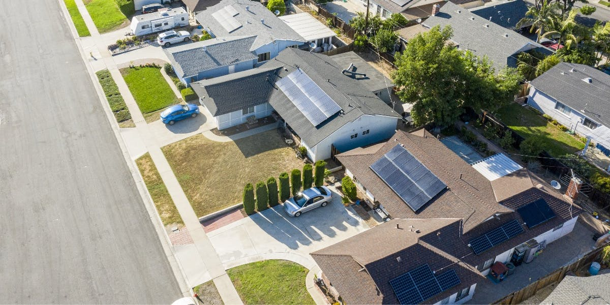 Solar powered homes with solar panels on various roof sizes and shapes.