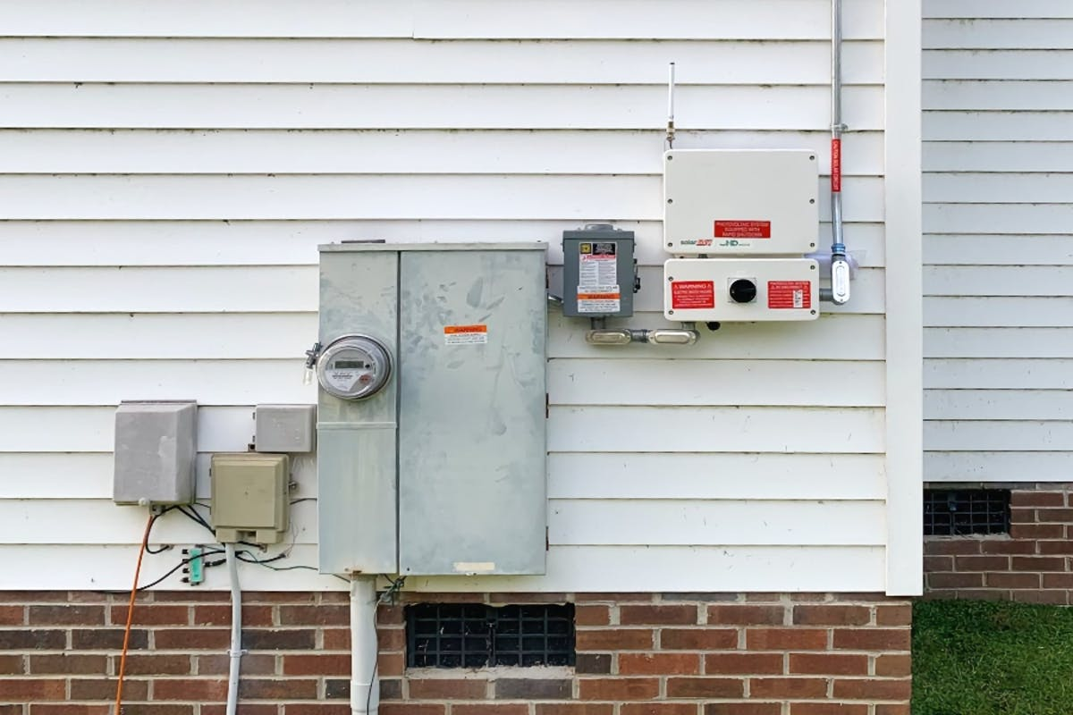 A home solar inverter converting DC energy into AC electricity to provide power.