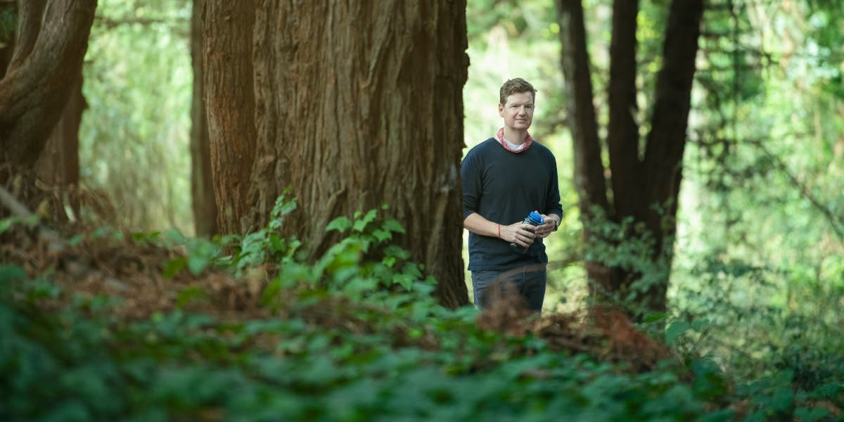 Chris Kemper in a forest.