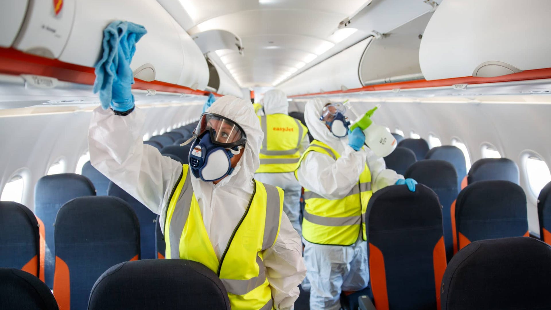Cleaners disinfecting Easyjet plane