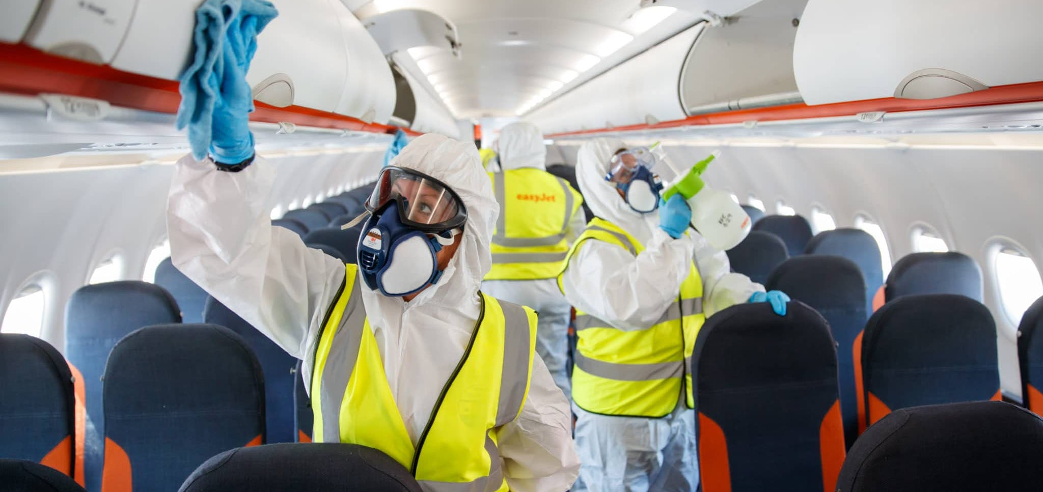 Cleaners disinfecting plane